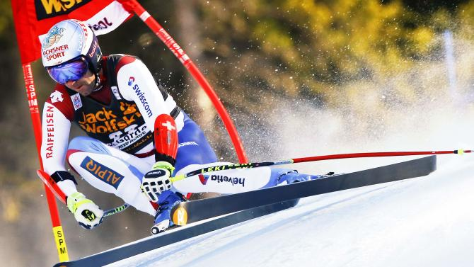 Defago of Switzerland clears a gate during the men's World Cup Super-G skiing race in Val Gardena