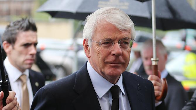 Former British Prime Minister Sir John Major arrives for the funeral of former Taoiseach Albert Reynolds at Sacred Heart Church, Donnybrook Dublin, Monday, Aug. 25, 2014. Generations of Irish leaders have united at the Dublin funeral of Ireland's peacemaking former prime minister, Albert Reynolds. The 81-year-old Reynolds died Thursday after a long battle with Alzheimer's disease. Monday's requiem Mass brought together many political rivals from past Republic of Ireland governments and the Northern Ireland peace process. (AP Photo/PA, Niall Carson) UNITED KINGDOM OUT, NO SALES, NO ARCHIVE