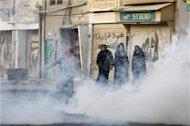 Police break up mass protests in Bahrain