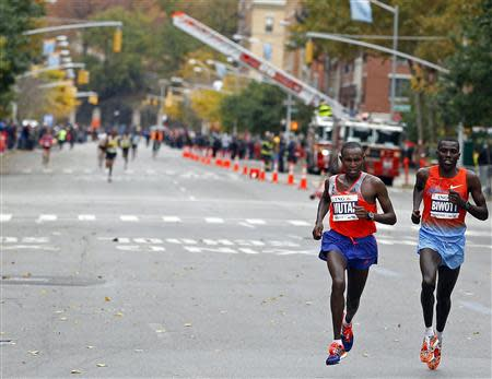 Mutai and Biwott, both of Kenya, make their way through the borough of Manhattan during the New York City Marathon