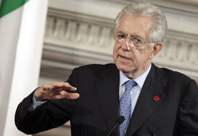 FILE - In this July 4, 2012 file photo Italian Premier Mario Monti gestures as he speaks during a joint press conference with German Chancellor Angela Merkel, unseen, during a bilateral meeting at Villa Madama in Rome. German news magazine Der Spiegel on Sunday, Aug. 5, 2012, quoted Monti as saying in an interview that &quot;the tensions accompanying the eurozone over the past years already bear the signs of a psychological dissolution of Europe.&quot; He further told the magazine that the euro&#39;s disintegration would &quot;destroy the founding of the European project.&quot; (AP Photo/Riccardo De Luca)