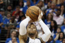 Dallas Mavericks' Monta Ellis (11) shoots a three-point basket agains the Houston Rockets in the second half of Game 4 in an NBA basketball first-round playoff series Sunday April 26, 2015, in Dallas. Ellis had a team-high 31-points in the 121-109 Mavericks win. (AP Photo/Tony Gutierrez)