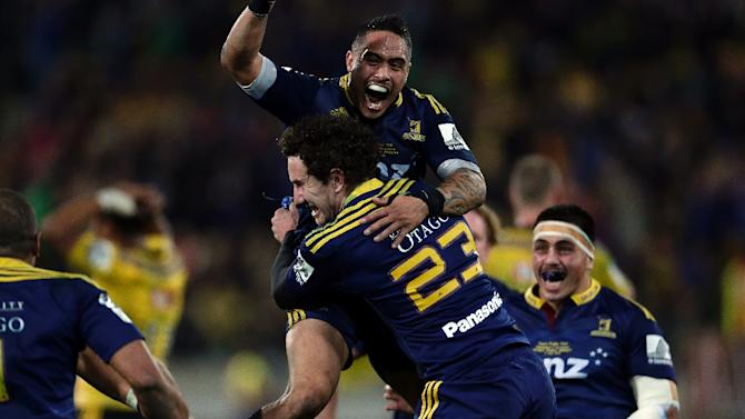 Highlanders players celebrate winning the Super 15 rugby union final between the Wellington Hurricanes and Otago Highlanders at Westpac Stadium in Wellington on July 4, 2015
