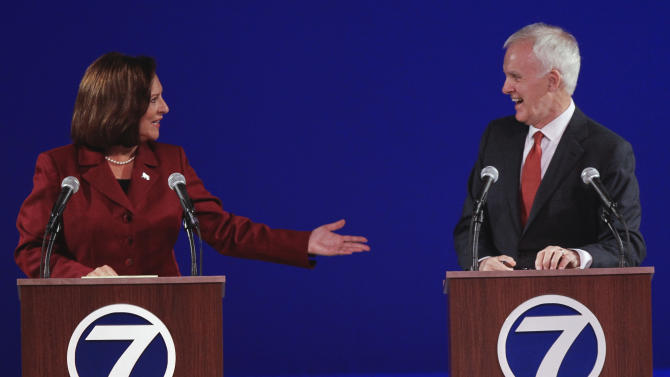 FILE - This file photo from Sept. 28, 2012 shows United States Senate candidates from Nebraska, Republican Deb Fischer, left, and Democrat Bob Kerrey, during their second debate in Omaha, Neb. With less than a week to go before Election Day, the atmosphere surrounding Nebraska's U.S. Senate race has taken on a frenzied aura as both Fischer and Kerrey push to sway voters. (AP Photo/Nati Harnik, File)