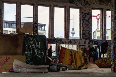 Roma migrant from Bulgaria stands outside his makeshift housing in a derelict factory in Berlin