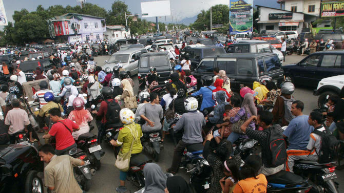 FILE- In this April 11, 2012 file photo, people are stuck in traffic as they evacuate to higher ground after a strong earthquake was felt in Banda Aceh, Aceh province, Sumatra island, Indonesia. Residents living in tsunami-scarred Aceh province should prepare themselves for a possible repeat of the 2004 disaster, a leading seismologist said, noting historical data indicates tremendous stresses building up along the explosive fault could unleash again anytime within the next half century. (AP Photo/Heri Juanda, File)