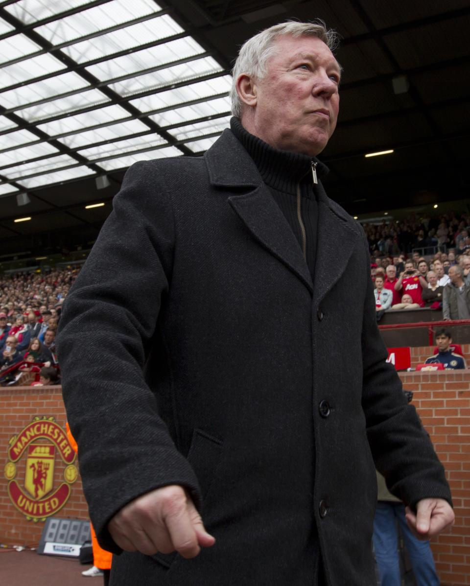 In this Sunday May 5, 2013 photo, Manchester United's manager Sir Alex Ferguson takes to the touchline before his team's English Premier League soccer match against Chelsea at Old Trafford Stadium, Manchester, England. Ferguson will step down as Manchester United manager at the end of the season after 26 years in charge. (AP Photo/Jon Super)
