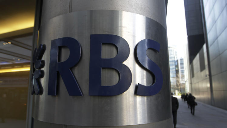 In this Friday, Jan. 27, 2012 photo, a sign of RBS, Royal Bank of Scotland, is seen at its office in the City of London. The value of global mergers and acquisitions deals in 2012 was nearly half the amount made five years ago, when the global financial crisis was first baring its teeth, a leading accounting and consulting firm said Wednesday, Dec. 12, 2012. There were a little under 37,000 deals worldwide, around 9,000 less than in 2007, when many companies indulged in a feverish bout of deal-making, many of which led to their financial ruin. Much of the blame for Royal Bank of Scotland PLC's near-collapse in 2008, which eventually required a government bailout, was due to its over-priced purchase of a large chunk of Dutch bank ABN Amro the year before. (AP Photo/Sang Tan)