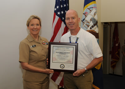 Jeff Gasser, Executive Vice President of Operational Readiness and Site Integration for Vogtle 3 and 4, accepts an award on behalf of Southern Nuclear from Vice Admiral Robin Braun, Chief of Navy Reserve. The award recognizes SNC as an outstanding employer in support of its Reserve sailors.