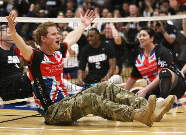 Britain's Prince Harry reacts while playing sitting volleyball with members of British Warrior Games team before opening of Warrior Games in Colorado Springs