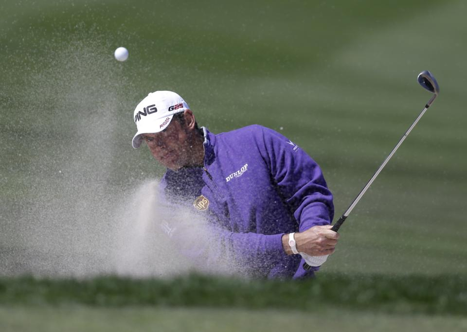 Lee Westwood, of England, hits out of a bunker on the third hole during the final round of the Honda Classic golf tournament on Sunday, March 3, 2013, in Palm Beach Gardens, Fla. (AP Photo/Wilfredo Lee)
