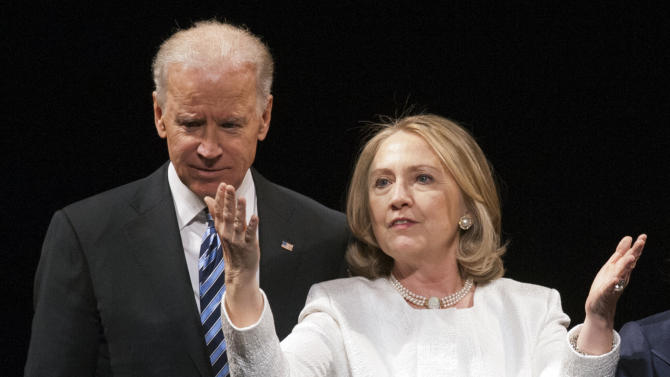 Vice President Joe Biden and former Secretary of State Hillary Rodham Clinton appear onstage at the Vital Voices Global Partnership 2013 Global Leadership Awards gala at the Kennedy Center for the Performing Arts in Washington, Tuesday, April 2, 2013. (AP Photo/Cliff Owen)