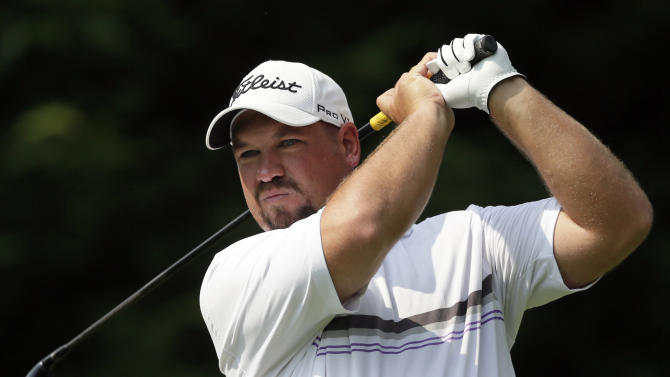 Brendon de Jonge watches his drive from the fifth tee during the third round of the AT&T National golf tournament at Congressional Country Club in Bethesda, Md., Saturday, June 30, 2012. (AP Photo/Patrick Semansky)