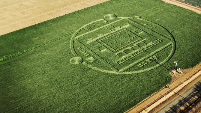 """This photo provided by Nvidia shows a 310-foot """"crop circle"""" in a California barley field that mystified locals this week was explained Sunday Jan. 6, 2014: it was a publicity stunt by Nvidia Corp., a maker of chips for PCs and smartphones. The crop circle near Chualar, Calif., contained a stylized image of a computer chip and the number """"192"""" in Braille. On Sunday, the company announced the Tegra K1, a new chip for tablets and smartphones that contains 192 computing """"cores,"""" or mini-computers, for graphics applications. (AP Photo/NVIDIA)"""