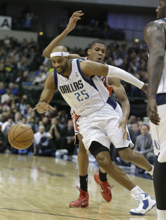 Dallas Mavericks guard Vince Carter (25) gets past Milwaukee Bucks forward John Henson (31) during the second half of an NBA basketball game Saturday, Dec. 14, 2013, in Dallas. The Mavericks won 106-9