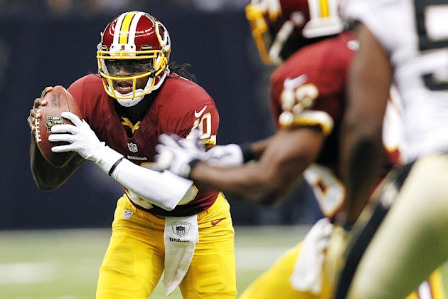 Washington Redskins quarterback Robert Griffin III (10) scrambles in the first half of an NFL football game against the New Orleans Saints in New Orleans, Sunday, Sept. 9, 2012. (AP Photo/Gerald Herbe