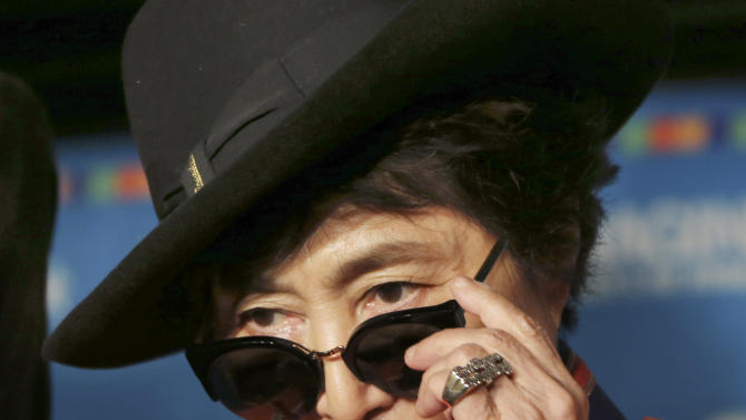 """Yoko Ono adjusts her sunglasses as she speaks during a campaign to fight childhood hunger around the world, in Tokyo Thursday, Dec. 5, 2013. The 80-year-old widow of John Lennon said that she believes he would be happy to see his song """"Imagine"""" used by WhyHunger and Hard Rock to raise support for their child nutrition and sustainable farming efforts in 22 countries. (AP Photo/Koji Sasahara)"""