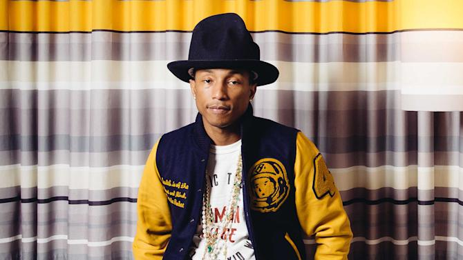 "In this March 25, 2014 photo, Pharrell Williams poses in Los Angeles. NBC has signed Williams as a coach for the upcoming seventh season of its musical competition series ""The Voice."" Earlier this year, Williams scored an Oscar nomination for his song ""Happy"" from the film ""Despicable Me 2."" He has had a Grammy-winning collaboration with Daft Punk on the dance hit ""Get Lucky."" (Photo by Casey Curry/Invision/AP)"