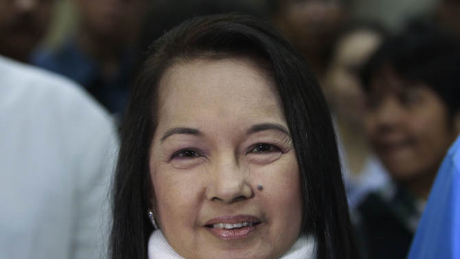 FILE - In this Feb. 23, 2012 file photo, former Philippine President and now Congresswoman Gloria Macapagal Arroyo arrives at a Pasay City Court for her arraignment on electoral fraud charges in Manila. The Philippine anti-graft court on Thursday, Oct. 4, 2012, ordered the arrest of Arroyo in the third corruption investigation against her, this one accused her of misusing $8.8 million in state lottery funds during her last years in office. (AP Photo/Bullit Marquez, Pool, File)