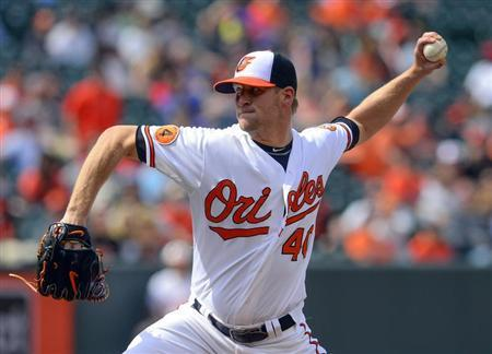 Baltimore Orioles relief pitcher Troy Patton throws against the Toronto Blue Jays during the tenth inning of their MLB American League baseball game in Baltimore