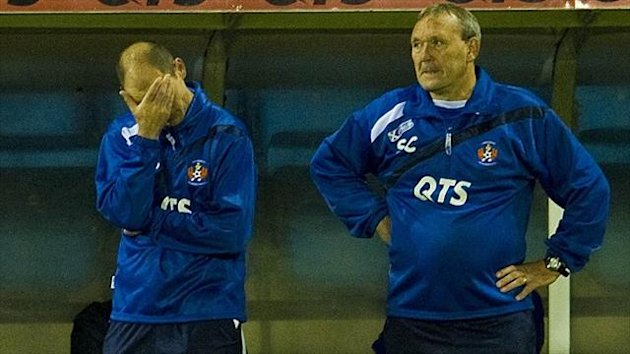 Kilmarnock manager Allan Johnston, left, holds his head as his assistant Sandy Clark looks on