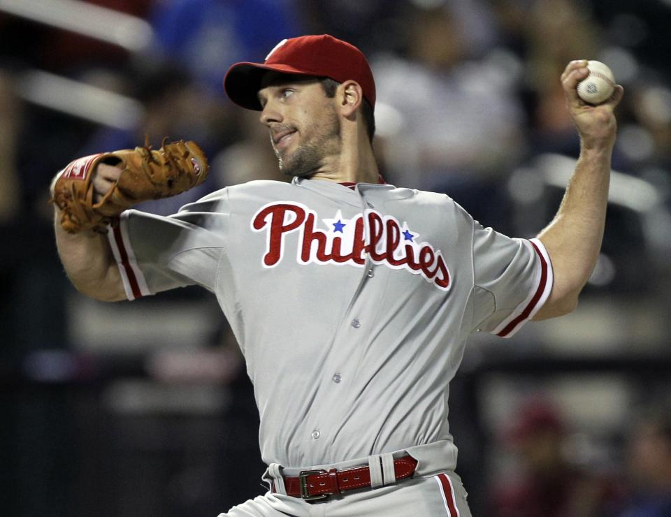 Philadelphia Phillies starting pitcher Cliff Lee winds up against the New York Mets in the third inning of the Phillies 3-1 victory of their baseball game at Citi Field in New York, Monday, Sept. 17, 2012. (AP Photo/Kathy Willens)