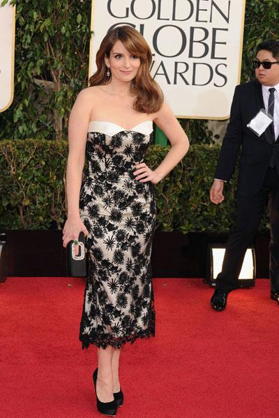 Tina Fey: We can't say enough how much we love Tina's glamorous locks. The Golden Globe co-host is cute in a black-and-white number which screams Parisian Chic. We can't wait to see her knock it out of the park on stage. (Photo by Steve Granitz/WireImage)