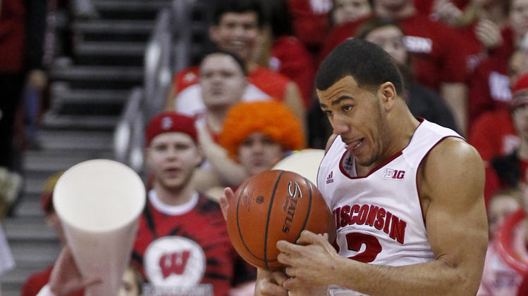 Ohio State's Aaron Craft (4) tips the ball away from Wisconsin's Traevon Jackson during the first half of an NCAA college basketball game on Sunday, Feb. 17, 2013, in Madison, Wis. (AP Photo/Andy Manis)