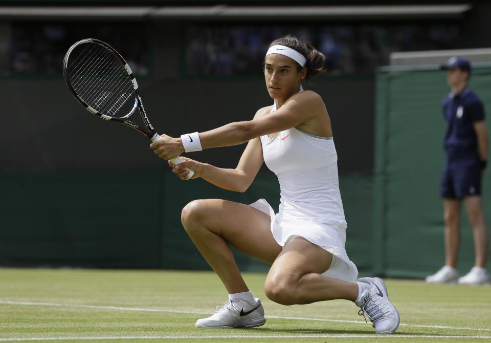 Caroline Garcia of France returns to Serena Williams of the United States during their Women's second round singles match at the All England Lawn Tennis Championships in Wimbledon, London, Thursday, June 27, 2013. (AP Photo/Alastair Grant)