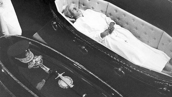 FILE - In this Dec. 7, 1974 file photo, the body of Eva Peron lies in state next to the remains of her husband Juan Domingo Peron, in Buenos Aires, Argentina. The uncertainty about the future is now invading millions of Venezuelans as it did Argentines almost 40 years ago with the death of Juan Domingo Peron; a charismatic military leader who became Argentina's most influential politician in the 20th century. (AP Photo/File)