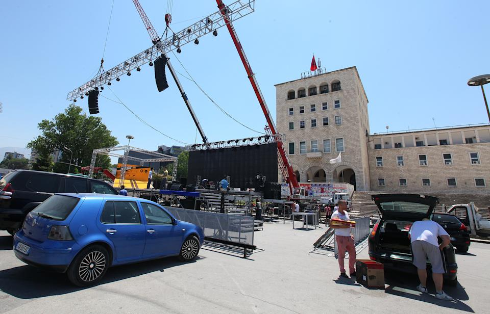 Dismantling equipment at the scene of the final political rally of Albania's governing Democratic Party in the capital Tirana Saturday, June 22, 2013. Political campaigning stops in Albania Saturday, a day before parliamentary elections which are considered a crucial test for its ambitions for closer ties and eventual membership in the European Union. (AP Photo/Hektor Pustina)