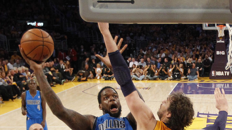 Dallas Mavericks' Eddy Curry (52) shoots against Los Angeles Lakers' Pau Gasol (16), of Spain, in the first half of an NBA basketball game in Los Angeles, Tuesday, Oct. 30, 2012. (AP Photo/Jae C. Hong)