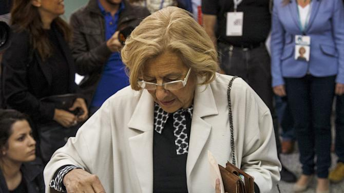 Carmena, local candidate of Ahora Madrid (Now Madrid), casts her vote at a polling station during regional and municipal elections in Madrid