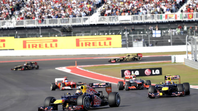 Red Bull driver Sebastian Vettel, left, of Germany, steers his car during the Formula One U.S. Grand Prix auto race at the Circuit of the Americas Sunday, Nov. 18, 2012, in Austin, Texas. (AP Photo/David J. Phillip)