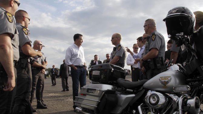 Republican presidential candidate, former Massachusetts Gov. Mitt Romney talks to state troopers during a stop in Pickaway County, Ohio on the way to a campaign event, Tuesday, Aug. 14, 2012.  (AP Photo/Mary Altaffer)