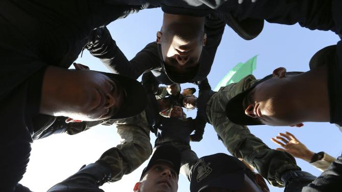 Palestinian youths demonstrate their skills during a military-style graduation ceremony after being trained at one of the Hamas-run Liberation Camps, in Khan Younis in the southern Gaza Strip