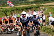 Bradley Wiggins of Great Britain (C) rides next to compatriot Chris Froome (R) during the men's road cycling race on day 1 of the London 2012 Olympic Games in London