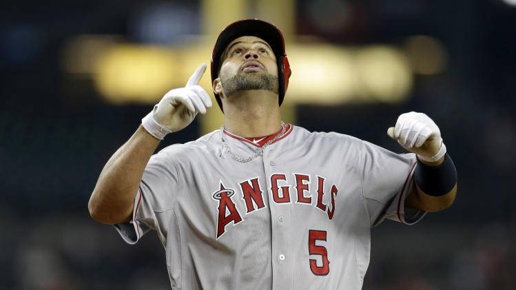 Los Angeles Angels' Albert Pujols looks skyward while crossing home plate after connecting for a three-run home run during the sixth inning of a baseball game against the Detroit Tigers in Detroit, Friday, April 18, 2014. (AP Photo/Carlos Osorio)