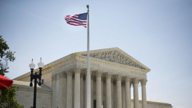 The Supreme Court building in Washington, Monday, June 30, 2014, following various court decisions. The court ruled on birth control, union fees and other cases. (AP Photo/Pablo Martinez Monsivais)