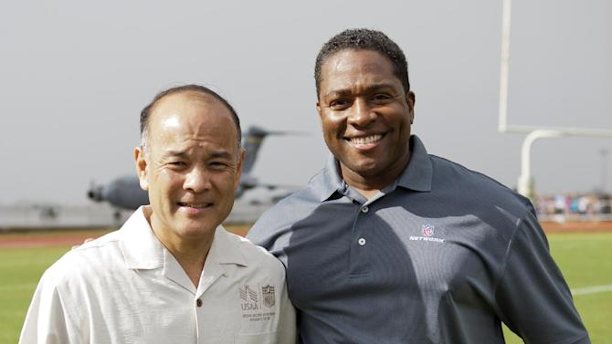 Ret. Major General Jason Kamiya, Senior Vice President at USAA, left, and Fran Charles of the NFL Network are seen during NFL Pro Bowl Practice at Joint Base Pearl Harbor Hickam, Thursday, Jan. 24. 2013 in Honolulu.  (Marco Garcia/AP Images for USAA)