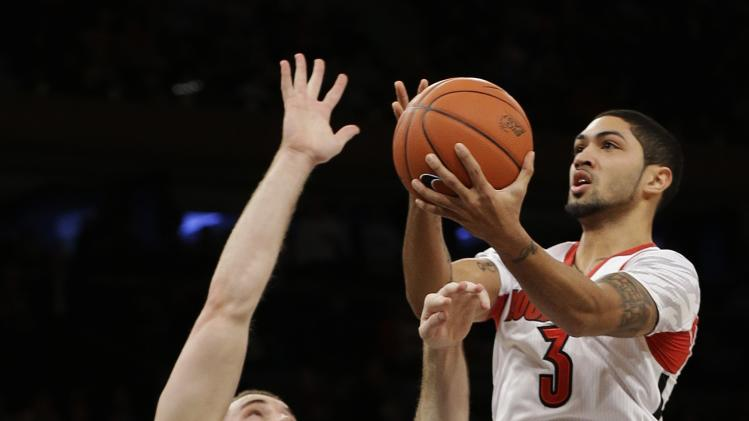Louisville's Peyton Siva (3) drives past Notre Dame's Pat Connaughton (24) during the first half of an NCAA college basketball game at the Big East Conference tournament Friday, March 15, 2013, in New York. (AP Photo/Frank Franklin II)