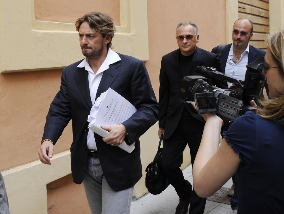 "FILE - In this Wednesday, June 8, 2011 file photo Giuseppe Signori, left, arrives at the Cremona court, Italy. Signori was among those arrested in ""Operation Last Bet"", a case overseen by Italian prosecutor Roberto Di Martino in the town of Cremona. (AP Photo/Antonio Calanni)"