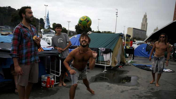 Argentinian fans play with a ball at a tent and motorhome park amongst others waiting out for Sunday's World Cup final between Argentina and Germany at the Terreirao do Samba in Rio de Janeiro