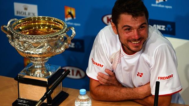 Switzerland's Stanislas Wawrinka smiles during a press conference following his men's singles final victory against Spain's Rafael Nadal (Getty Images)