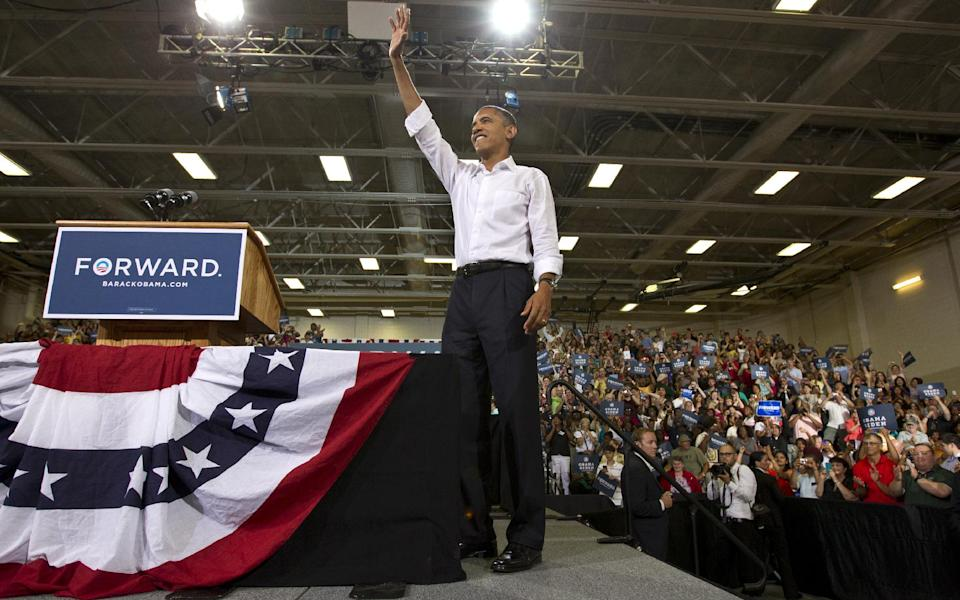 President Barack Obama holds a campaign rally at Centreville High School in Clifton, Va., a Washington suburb, Saturday, July 14, 2012. Virginia is a crucial swing state that Obama won four years ago. (AP Photo/J. Scott Applewhite)