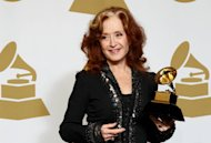 Bonnie Raitt poses backstage with the award for best americana album for &quot;Slipstream&quot; at the 55th annual Grammy Awards on Sunday, Feb. 10, 2013, in Los Angeles. (Photo by Matt Sayles/Invision/AP)