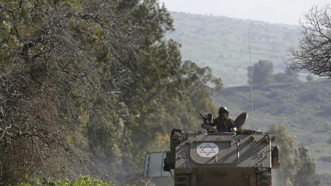 An Israeli soldier rides an armoured military ambulance Israel's border with Lebanon