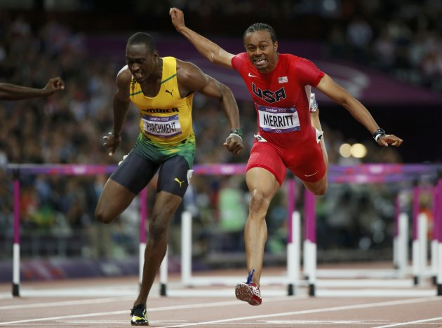 Aries Merritt of the U.S. (R) finishes first of Jamaica's Hansle Parchment during their men's 110m hurdles final during the London 2012 Olympics Games at the Olympic Stadium August 8, 2012. Merritt finished first and Parchment third. REUTERS/Lucy Nicholson (BRITAIN  - Tags: SPORT OLYMPICS SPORT ATHLETICS)