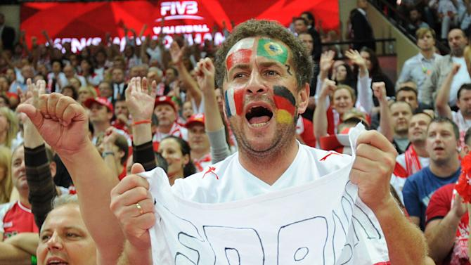 Polish fans cheer their team during the FIVB Men's Volleyball World Championships final game between Brazil and Poland in Katowice, Poland, Sunday, Sept. 21, 2014. (AP Photo/Alik Keplicz)