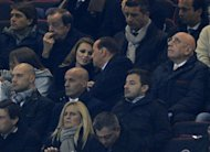 MILAN, ITALY - DECEMBER 04: Silvio Berlusconi (C), Francesca Pascale (L) and Adriano Galliani (R) attend the UEFA Champions League group C match between AC Milan and Zenit St Petersburg at San Siro Stadium on December 4, 2012 in Milan, Italy. (Photo by Claudio Villa/Getty Images)